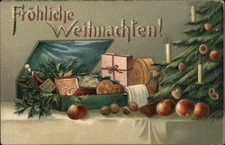 Frohliche Weihmachten! - Christmas tree with box of food on the table