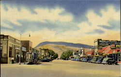 Main Street And Business District Cody, Rattlesnake Mountain In Background