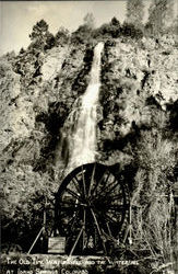 The Old Time Waterwheel And The Waterfall