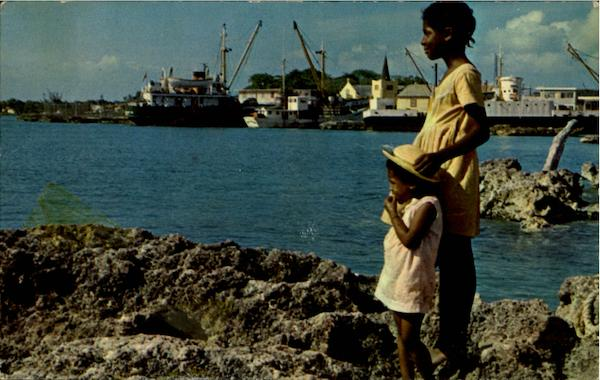 Caymanian Youngsters Gaze Out To Sea At Georgetown Harbour Cayman Islands