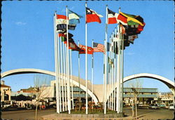 Avenue Of Flags And Twin Spans Of The New Immigration Station Postcard