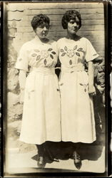 Two Women Matching Dresses