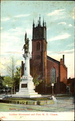 Soldiers Monument And First M. E. Church