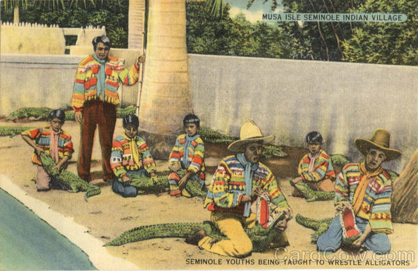 Seminole youths being taught to wrestle Alligators, N. W. 25th Ave. & 16th St Miami Florida