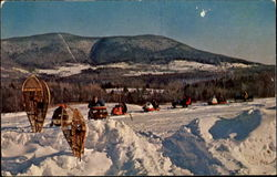 Snowmobiles Return From The Trail
