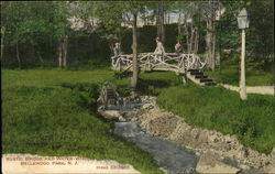 Rustic Bridge And Water Wheel