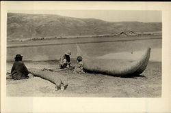 Mending A Straw Boat On The Shore Postcard