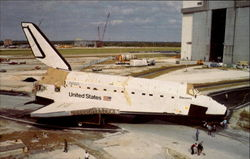 Space Shuttle Discovery is towed to the Vehicle Assembly Building