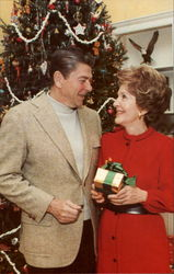 President And Mrs. Reagan Exchange Gifts At Their First White House Christmas