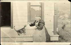 Woman Feeding Cat