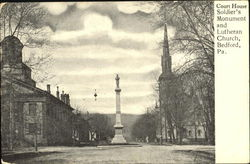Court House Soldier's Monument And Lutheran Church Postcard