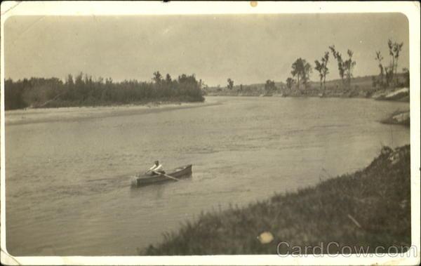 Man in Rowboat Canoes & Rowboats