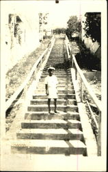 Boy on Stairs Postcard