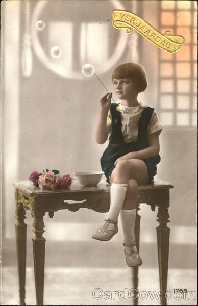 A young girl blows bubbles Girls