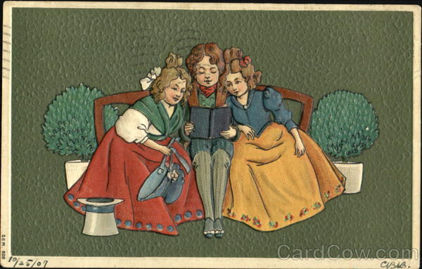 A boy sitting between two little girls reading Children