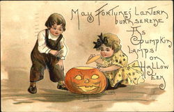 Two children (boy and girl) playing with a Jack-o-lantern