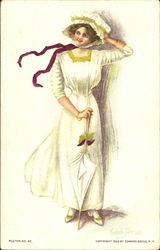 Woman in 19th century white dress with white umbrella on a windy day