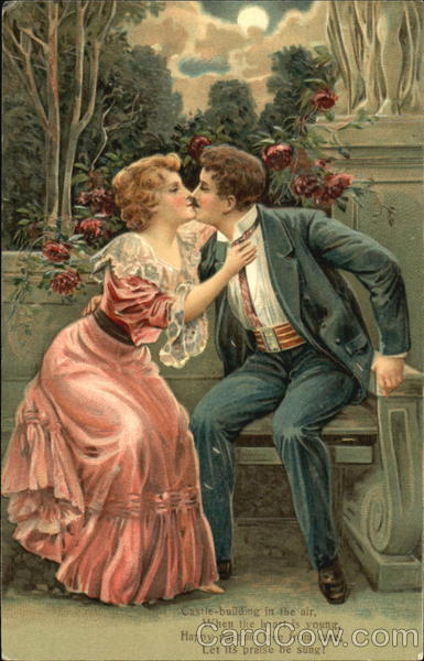 A couple kissing on a bench Romance & Love