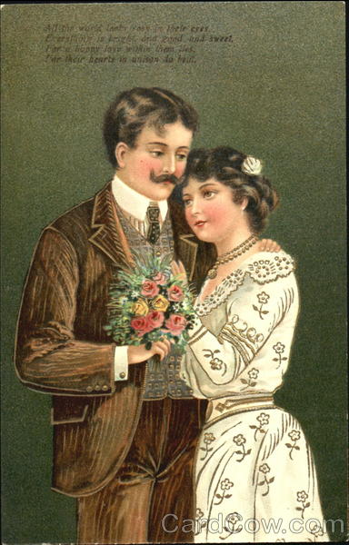 A couple posing for a picture with flowers in hand