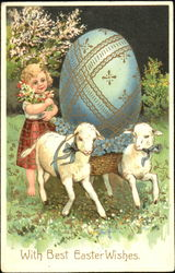 Little girl with two lambs and and Easter egg