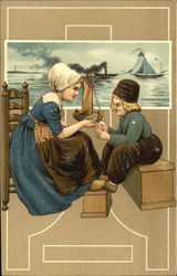 Dutch mother and son with boats