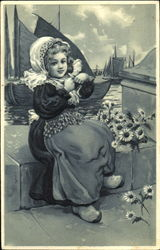 Girl with flowers sitting on a dock
