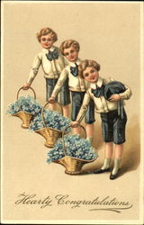 Boys with baskets of blue flowers