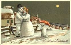 A Christmas Snowman Couple and Snowdog Out for a Stroll