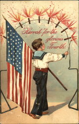 Patriotic picture of a boy with the American flag and lighting fireworks