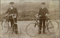 Man & Boy with Bicycles (Postmen?)