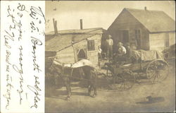 Horse-Drawn Wagon and Wood Frame House
