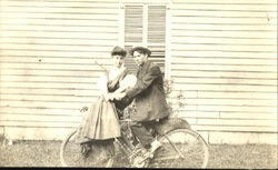 Couple on an Early Indian Motorcycle