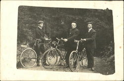 Three Men in Suits with Bicycles