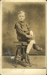 Portrait of Boy sitting on a Stool