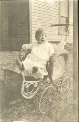 Baby in Wicker Baby Carriage