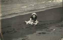 Tahitian woman lying on the beach