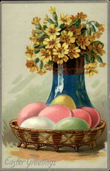 Easter eggs and vase of flowers