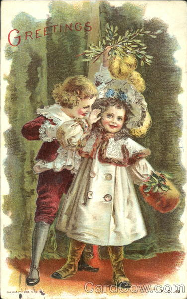 Boy and girl under mistletoe Children