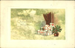 White boxes wrapped with red ribbons a Holly plant by their side Postcard