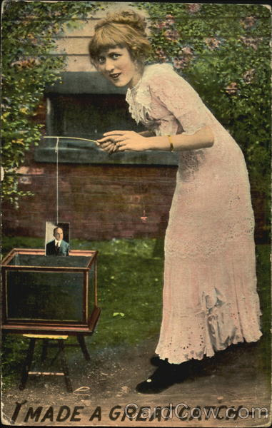 Woman fishing for pictures in fish tank Women
