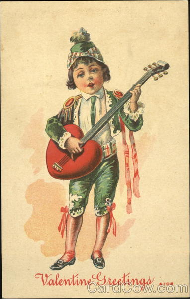 Boy singing holding a heart guitar Children