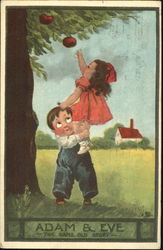 Boy helping girl reach an apple on a tree
