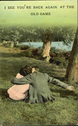 Couple sitting on the grass kissing