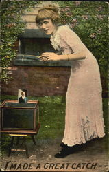 Woman fishing for pictures in fish tank