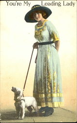 Lady in hat with dog on leash