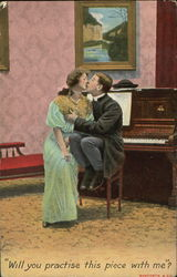 Couple kissing in front of piano