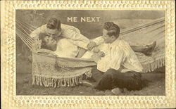 Man Kissing Woman in Hammock next to Seated Man