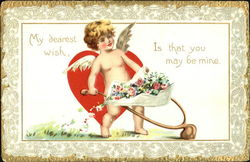 Cupid pushin flowers in a wheel barrel Postcard