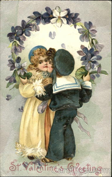 A boy kissing a girl surrounded by flowers Children