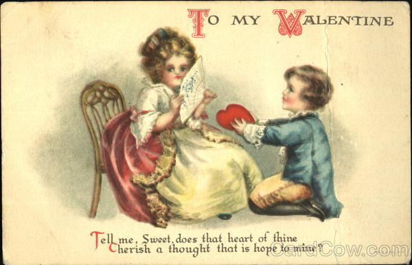 A young boy giving this young girl a red valentine heart